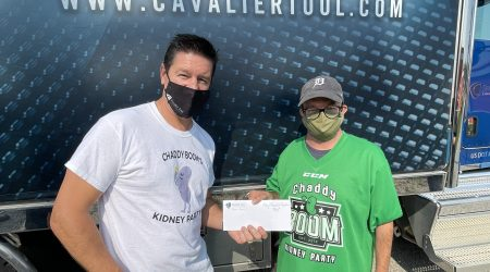 Brian Bendig presenting donation to Chad Gibbons